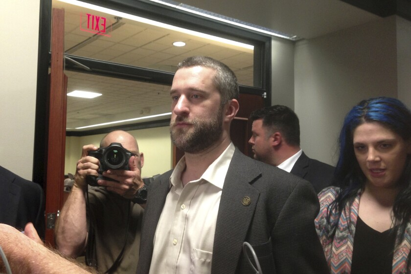 FILE - In this May 29, 2015, file photo, television actor Dustin Diamond, center, leaves court in Port Washington, Wis., after being convicted of two misdemeanors stemming from a barroom fight on Christmas Day 2014. Diamond is undergoing chemotherapy treatments after being diagnosed with cancer, according to his representative. Diamond, best known for playing Screech on the hit '90s sitcom, was hospitalized earlier this month in Florida. Last week, his team disclosed he did have cancer. (AP Photo/Dana Ferguson, File)
