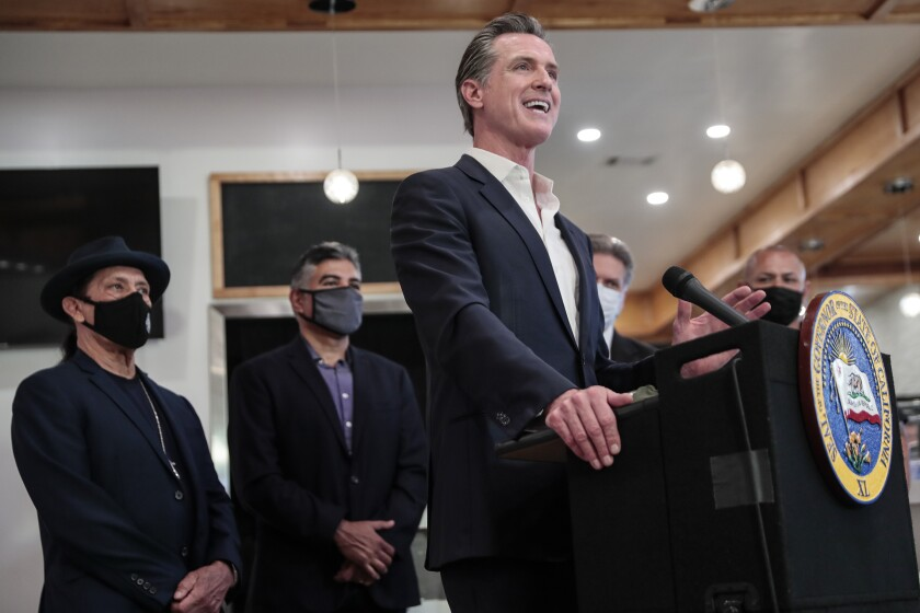 California Gov. Gavin Newsom speaks during a news conference in San Fernando on April 29.