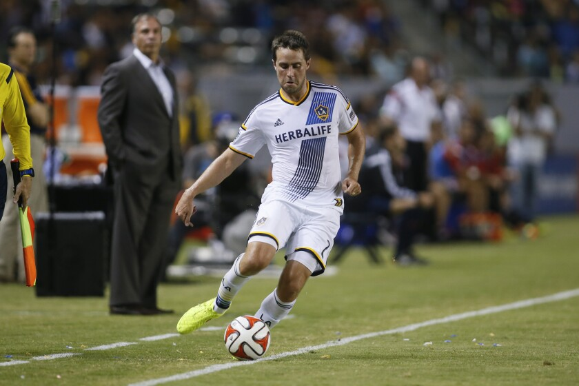 FILE - In this Aug. 27, 2014, file photo, Los Angeles Galaxy's Todd Dunivant plays the ball during an MLS soccer match against D.C. United in Carson, Calif. Dunivant, now president and general manager of the Sacramento Republic FC, along with his staff and players are preparing for the upcoming USL season to start in May and continuing the work on moving forward with the club's Major League Soccer expansion plans. (AP Photo/Danny Moloshok, File)