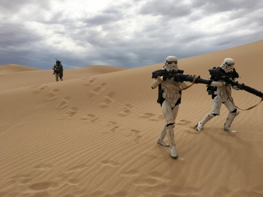 """A scene from """"The Sable Corsair, """" a five-minute """"Star Wars"""" fan film about a group of smugglers who crash-land on a desert planet. Boba Fett (Ramey Chanadet), with two Imperial Sandtroopers from the Route No. 66 Patrol of the 501st Legion."""