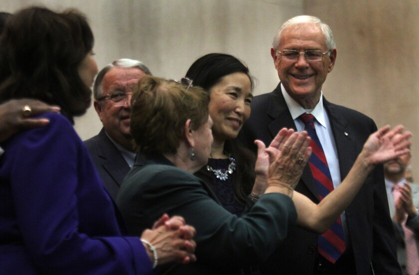 Los Angeles County Chief Executive Officer Sachi Hamai, center, at her swearing-in ceremony at the Board of Supervisors last October.