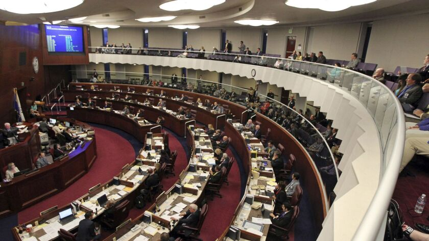 FILE - In this June 1, 2015, file photo, members of the Nevada State Assembly work late into the nig