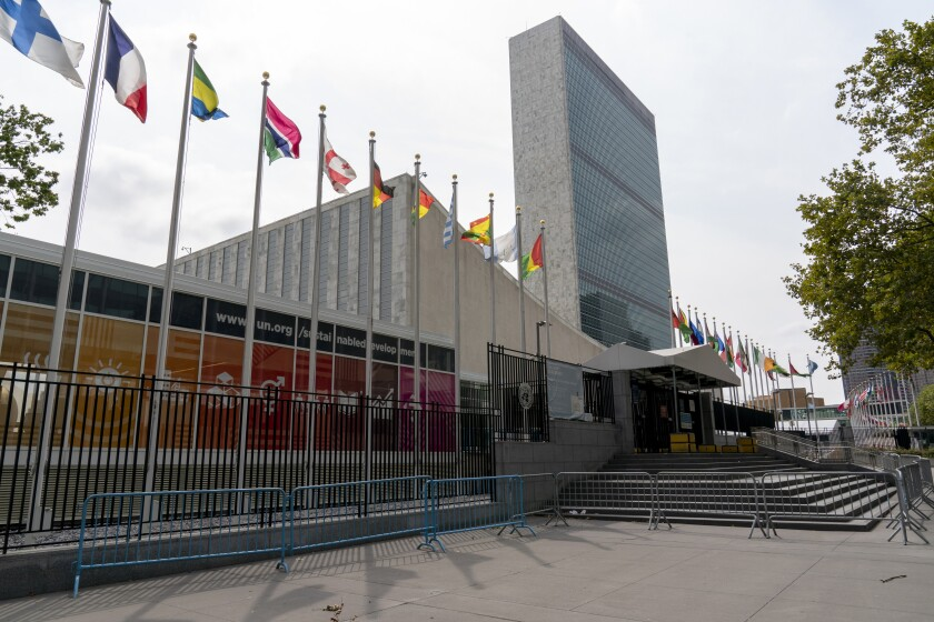 Metal barricades line the the shuttered main entrance to the United Nations headquarters, Friday, Sept. 18, 2020, in New York. With the COVID-19 pandemic still circling the globe, world leaders are skipping their annual gathering in New York and will make pre-recorded speeches this week on the state of a deeply divided world turned topsy-turvy. (AP Photo/Mary Altaffer)