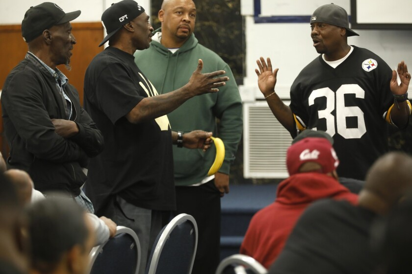 "Frederick ""Gangster"" Staves of the Santana Blocc Crips, second from left, makes a point to Robinson ""G-Nutt"" Lonnell of the 151 Pirus, far right, at a gang peace summit in Compton."