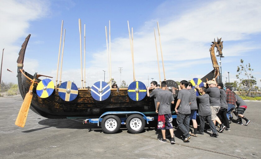 Marina High's wood shop students move the authentic Viking ship Valhalla towards the Sunset Aquatic Marina boat launch after years of building and crafting the boat in class.