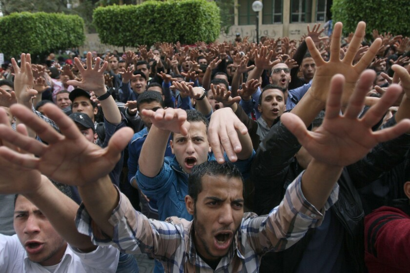 Egyptian students from Cairo University demonstrate in support of ousted Islamist President Mohamed Morsi. An Egyptian court sentenced 529 Morsi supporters to death in the killing of a police officer.