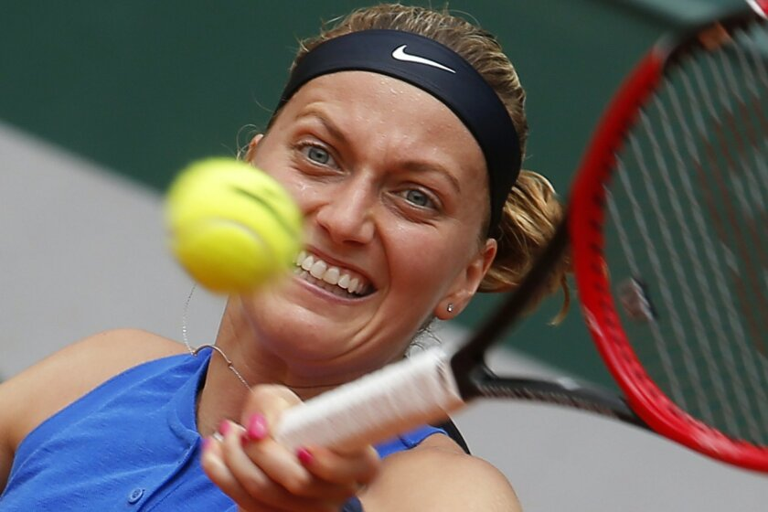 Petra Kvitova of the Czech Republic returns in her third round match of the French Open tennis tournament against Shelby Rogers of the U.S. at the Roland Garros stadium in Paris, France, Friday, May 27, 2016. (AP Photo/Michel Euler)