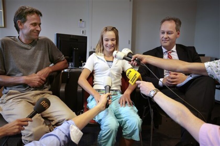 FILE - This Aug. 24, 2009 file photo shows from left: Dick Dekker, his daugher Laura Dekker and her lawyer Peter de Lange during a press conference in the courtroom in Utrecht, Netherlands. A Dutch court ruled Friday Oct. 30, 2009 that 14-year-old Laura Dekker was still too inexperienced to be allowed to set off on her quest to become the youngest person to sail solo around the world. Judges at Utrecht District Court placed Laura under the guardianship of child protection authorities until next July to ensure that she cannot set off on her dream voyage. The ruling means Laura can continue living with her father but her parents must consult child protection authorities about all major decisions in her life. (AP Photo/ Bart Muhl, File)