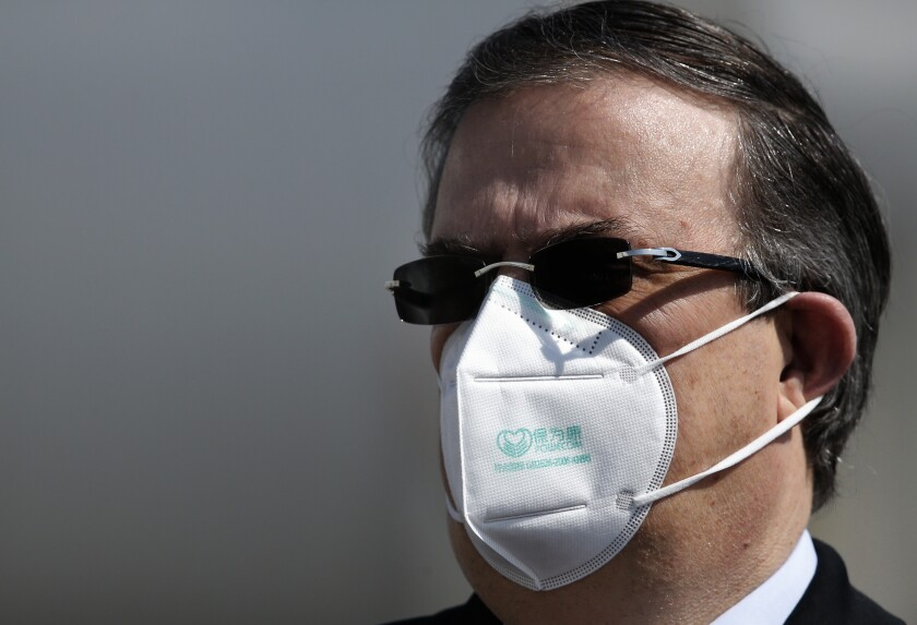 Mexican Foreign Minister Marcelo Ebrard wears a mask against the spread of the coronavirus.