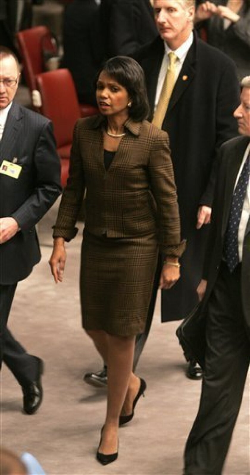 U.S. Secretary of State Condoleezza Rice walks through the Security Council before a meeting at the United Nations headquarters Wednesday, Jan. 7, 2009. Rice extended a visit to New York to participate in talks at the United Nations on an Egyptian-French proposal for a truce to end fighting in the
