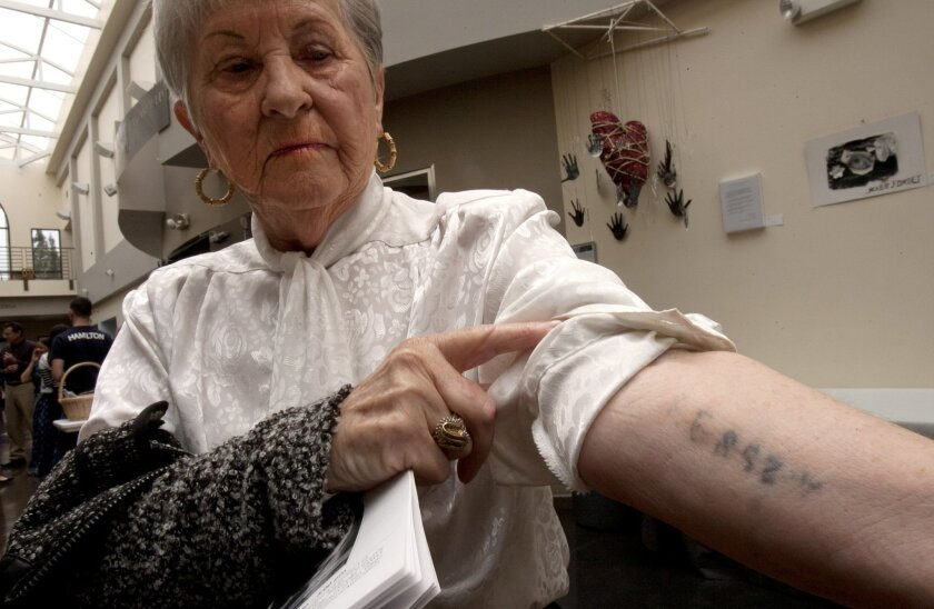 Holocaust survivor Rose Schindler, 83, shows the tattoo she was branded with at age 14 in a Nazi work camp where she survived for 8 months until the war ended during a Yom HaShoah, or National Holocaust Remembrancel Day ceremony Sunday at the Lawrence Family Jewish Community Center in La Jolla.