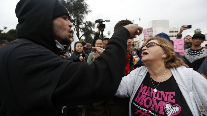 BEVERLY HILLS, CALIF. - MAR 13, 2018. Pro- and anti-Trump denonstrators get into a verbal confront