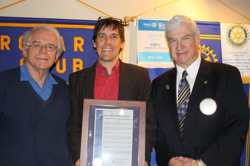 Bob Goodman, president 2015-2016; Jay coggan, president 2014-2015; and Gordon shurtleff, president 2013-2014 with the plaque declaring March 4, 2015 'Torrey Pines la Jolla Rotary Club Day' in the city of san Diego.