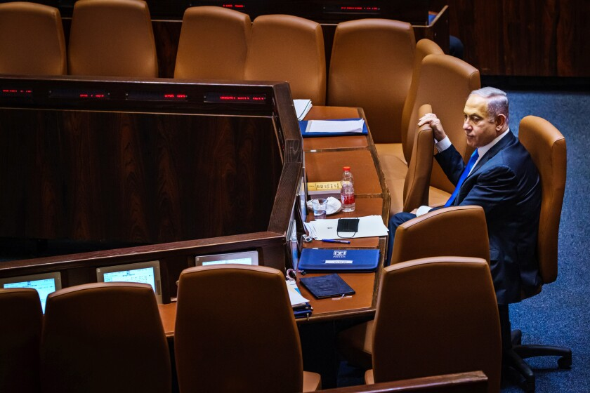 Then-outgoing Prime Minister Benjamin Netanyahu awaits the Israeli Knesset's vote to empower the new government