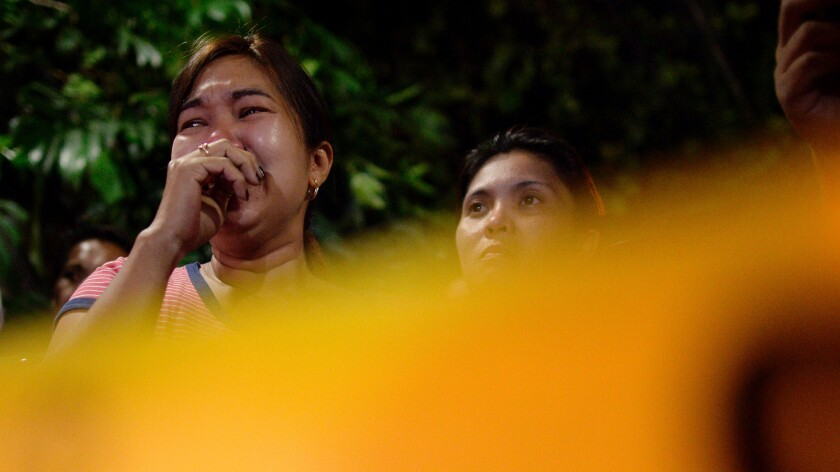 Relatives of a tricycle driver shown grieving after he was killed in July by an unidentified gunman for being a suspected drug dealer.