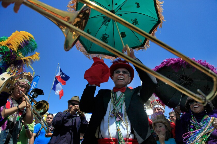 Bill Doucette and the Euphoria Brass Band celebrate with the traditional sound of New Orleans at the Gator by the Bay Festival Sunday.