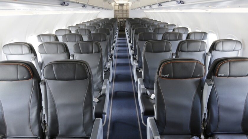 FILE - This Thursday, March 16, 2017, file photo shows the interior of a commercial airliner at John