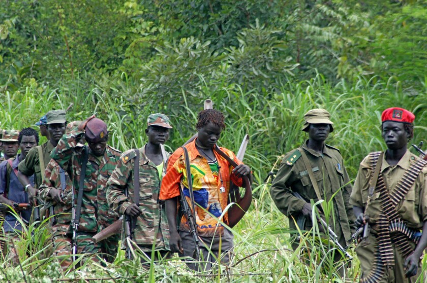 Members of Uganda's Lord's Resistance Army wait as their leader, Joseph Kony, meets with a delegation of Ugandan officials and others in the Democratic Republic of Congo.