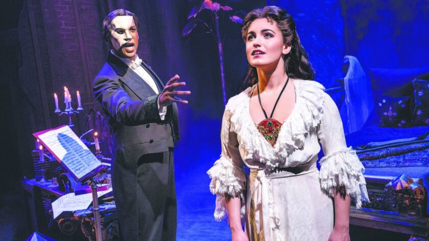 "Quentin Oliver Lee and Eva Tavares in ""The Phantom of the Opera."""