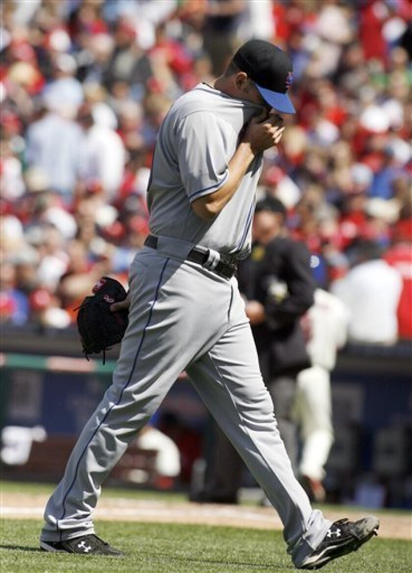 New Yorks Mets starting pitcher Jonathon Niese walks off the field after getting relieved in the seventh inning of a baseball game against the Philadelphia Phillies, Saturday, April 30, 2011, in Philadelphia. The Phillies won 2-1. (AP Photo/H. Rumph Jr)