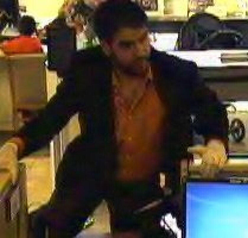 A surveillance photo of the robber at a Wells Fargo in Fallbrook. / FBI