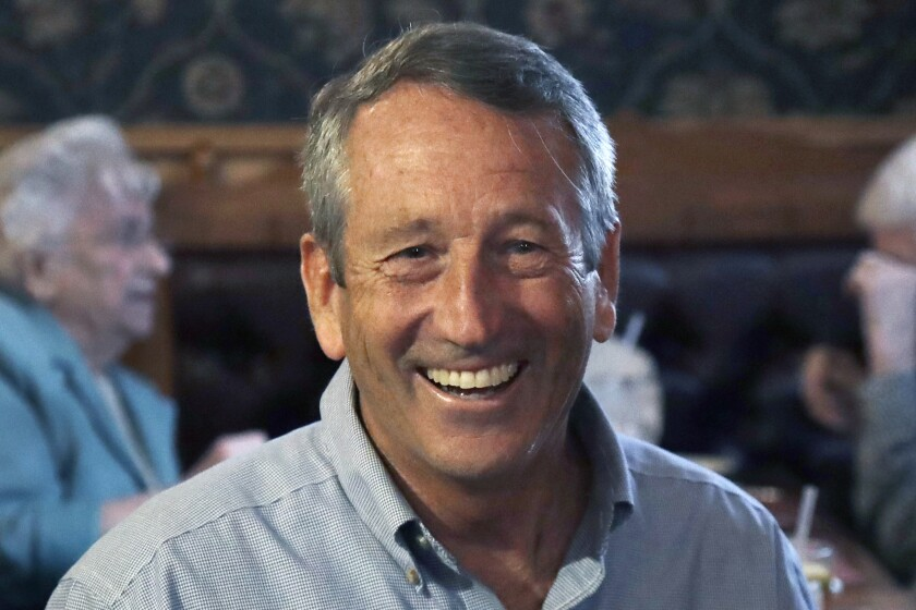 FILE - In this Sept. 19, 2019 file photo, Republican presidential candidate, former South Carolina Gov. Mark Sanford, smiles as he talks with customers at the Puritan Backroom restaurant, during a campaign stop in Manchester, N.H. Sanford is ending his longshot 2020 presidential bid. The former South Carolina governor and congressman centered his Republican primary challenge to President Donald Trump on warnings about the national debt. But he struggled to gain traction since announcing his run in September. (AP Photo/Elise Amendola)