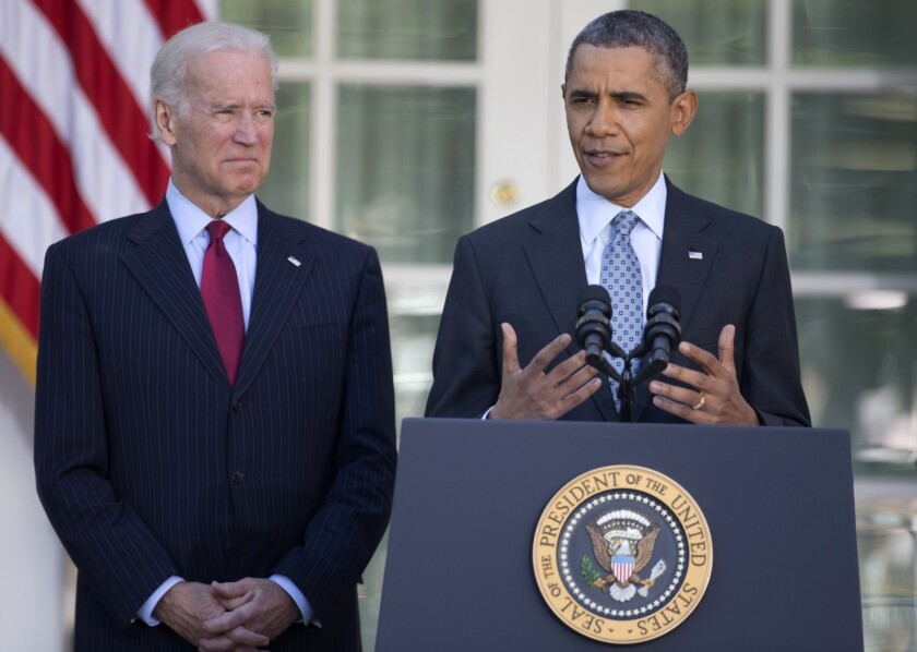 President Obama, with Vice President Joe Biden, speaks to reporters in the Rose Garden of the White House on Tuesday. The president said more than 7 million people signed up under the Affordable Care Act for healthcare insurance.