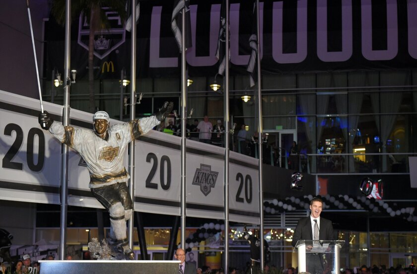Former Los Angeles Kings left wing Luc Robitaille speaks after a statue of his likeness was unveiled in front of the Staples Center, Saturday, March 7, 2015, prior to an NHL hockey game against the Pittsburgh Penguins in Los Angeles. Robitaille is currently the president of business operations for