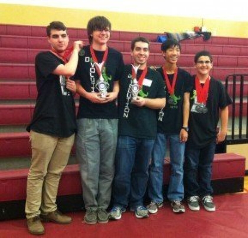 CCA De-Evolution robotics team members: (L-R) Kian Sheik, Noah Sutton-Smolin, Tristan Murphy, Alex Quan, Christian Cooper. Not pictured: Mariella Gauvreau, Ryan Lee, and Yousuf Soliman. Noah and Tristan are holding the two trophies for winning the Inspire Award and for Captain of the Winning Alliance.
