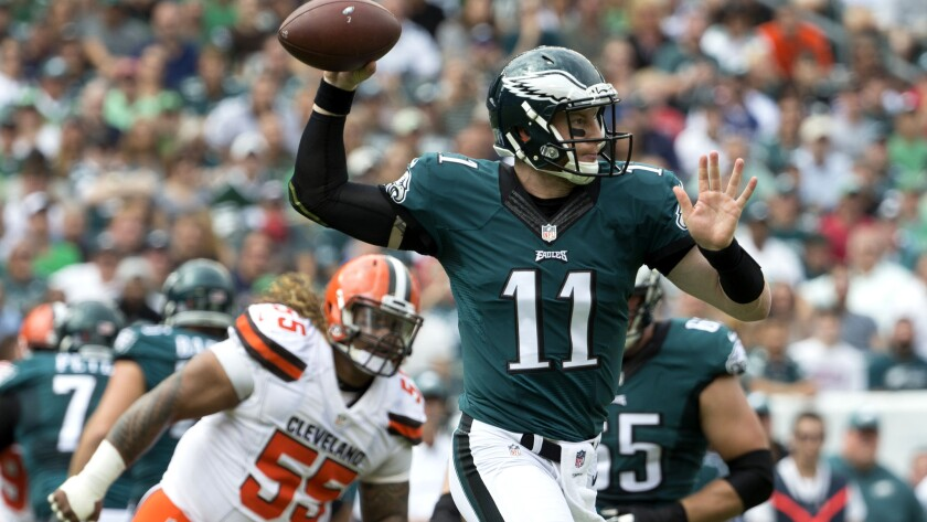 Eagles quarterback Carson Wentz prepares to pass while scrambling against the Browns on Sunday.