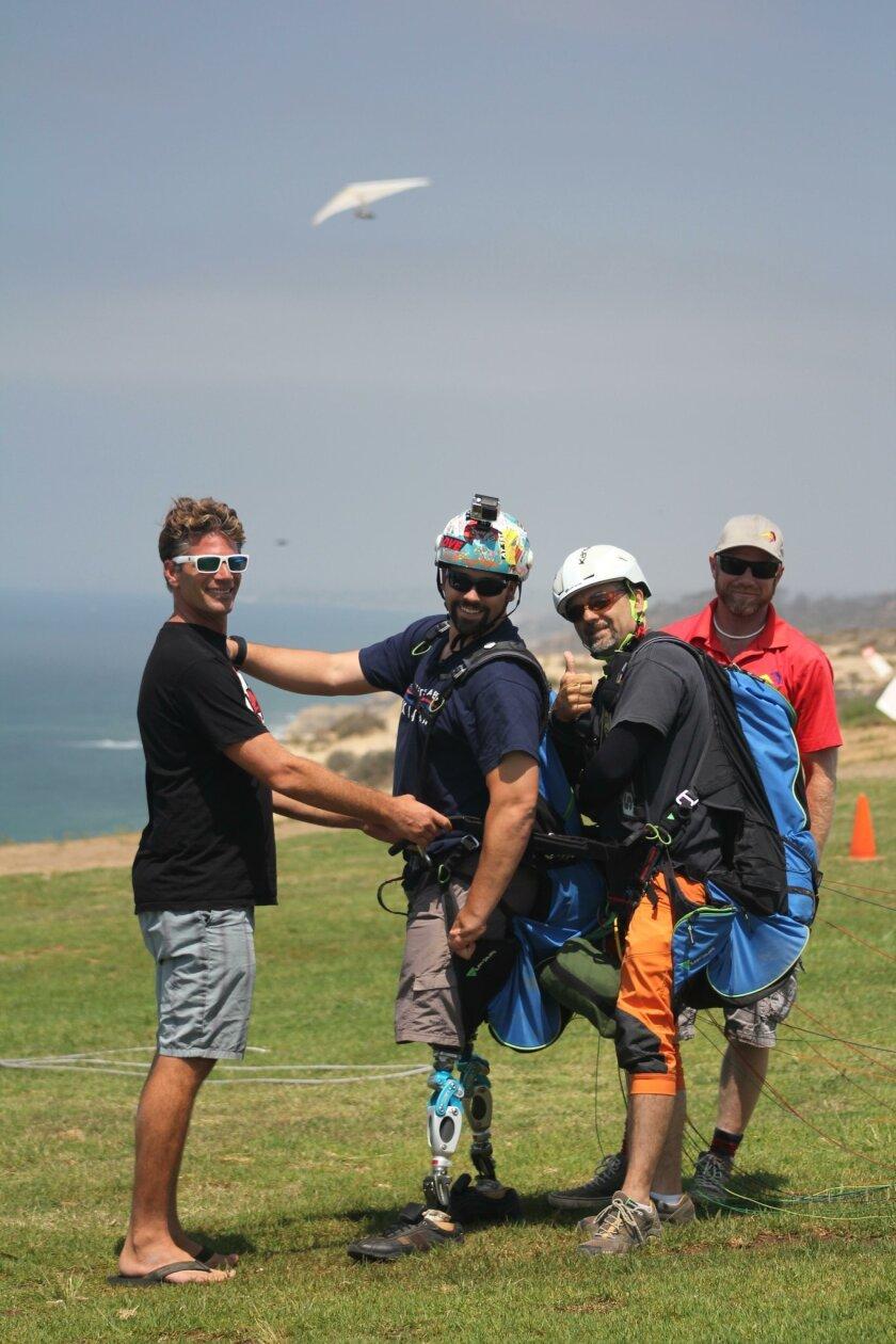 Gabriel Jebb, Joshua Elliot, J.C. Perren and Damien Burch prepare to spread the wings.