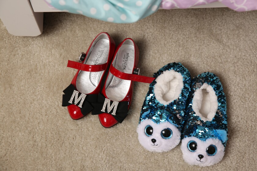 Slippers and shoes sit by Mykal-Michelle Harris' bed.