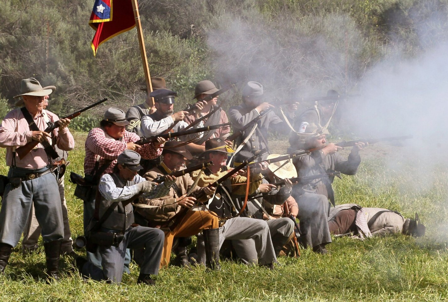 Confederate soldiers fire at the Union soldiers.