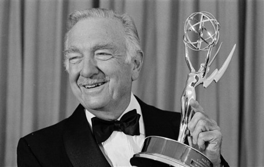 FILE - In this Sept. 9, 1979, file photo, CBS anchorman Walter Cronkite poses with his Emmy at the 31st Emmy Awards in Los Angeles, Calif.  Famed CBS News anchor Walter Cronkite, known as the 'most trusted man in America' has died, Friday, July 17, 2009. He was 92. (AP Photo/Reed Saxon, File)