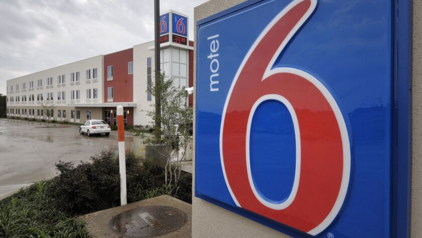 Motel 6 has agreed to pay as much as $7.6 million to guests who said the chain gave their private information to U.S. immigration agents.