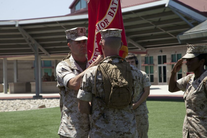 U.S. Marine Corps Lt. Col. Brian Dwyer, right, outgoing commanding officer, Wounded Warrior Battalion-West, relinquishes command to Lt. Col. Stephen Mount, left, commanding officer, WWBN-W, during a Change of Command Ceremony at Camp Pendleton, Calif., June 30, 2016.  A Change of Command is a milit