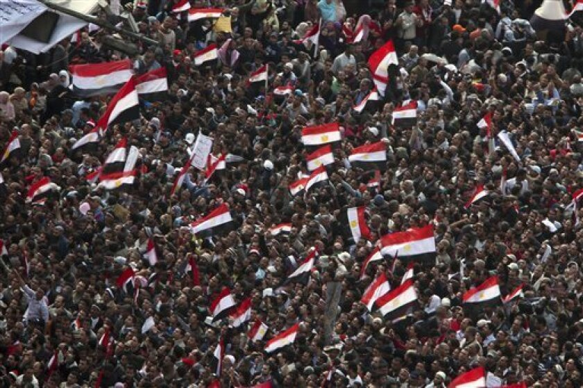 Anti-government protesters demonstrate after traditional Muslim Friday prayers at the continuing demonstration in Tahrir Square in downtown Cairo, Egypt Friday, Feb. 11, 2011. (AP Photo/Tara Todras-Whitehill)