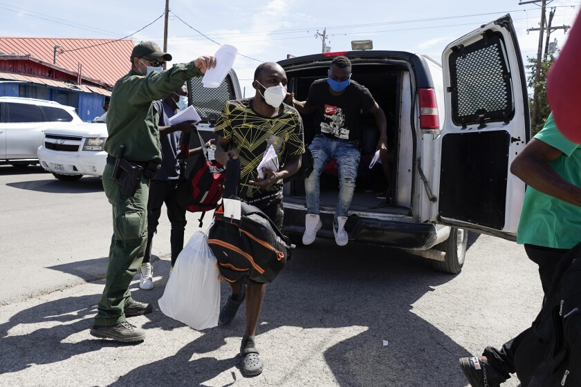 Migrants, many from Haiti, are seen at an encampment in Del Rio, Texas.