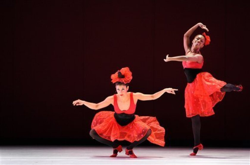"""This undated image released by the Paul Taylor Dance Company shows Parisa Khobdeh, center, and Michelle Fleet during a performance of """"Offenbach Overtures,"""" performing thru March 24, 2013, at the David H. Koch Theater at Lincoln Center in New York. (AP Photo/Paul Taylor Dance Company, Paul B. Goode)"""