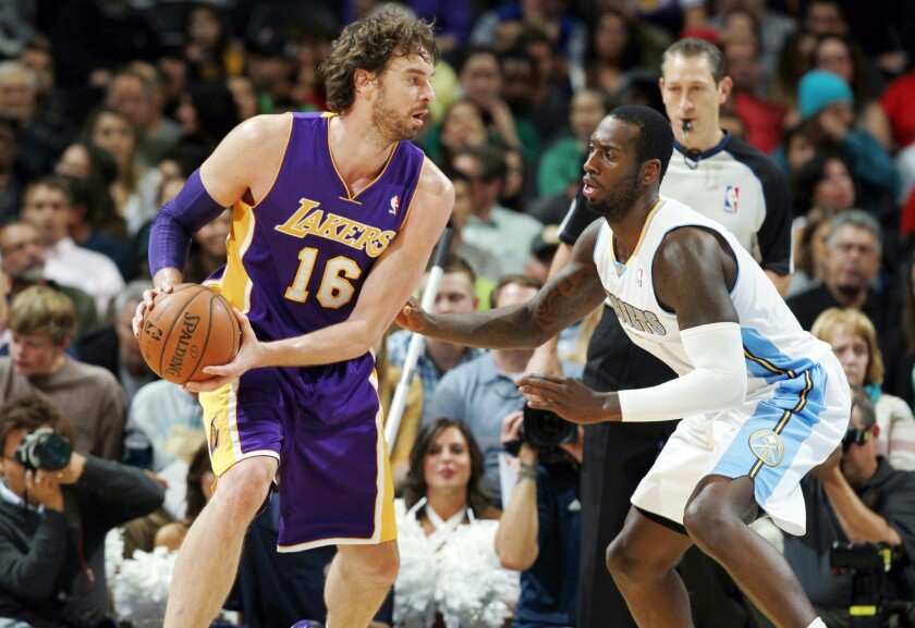 Lakers forward Pau Gasol, left, tries to work inside on Denver Nuggets forward J.J. Hickson during the Lakers' 111-99 loss Wednesday. The Lakers have struggled in the second game of back-to-back contests.