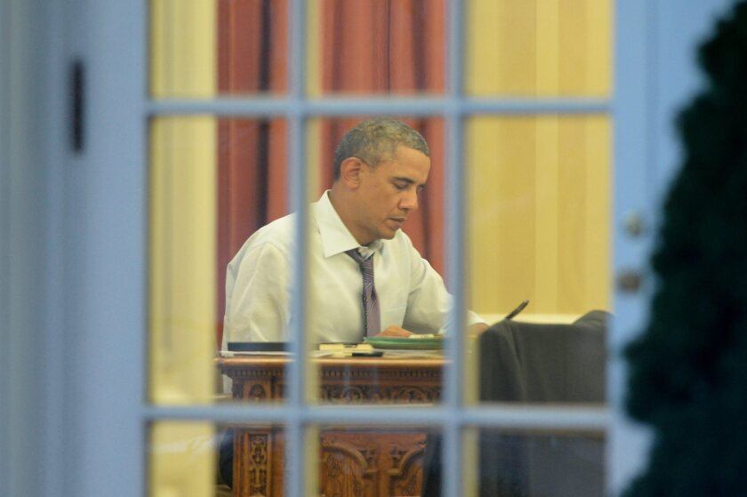 President Obama works on his State of the Union address, to be delivered Tuesday. Many key Senate contests are taking place this year in states where the president is relatively unpopular.