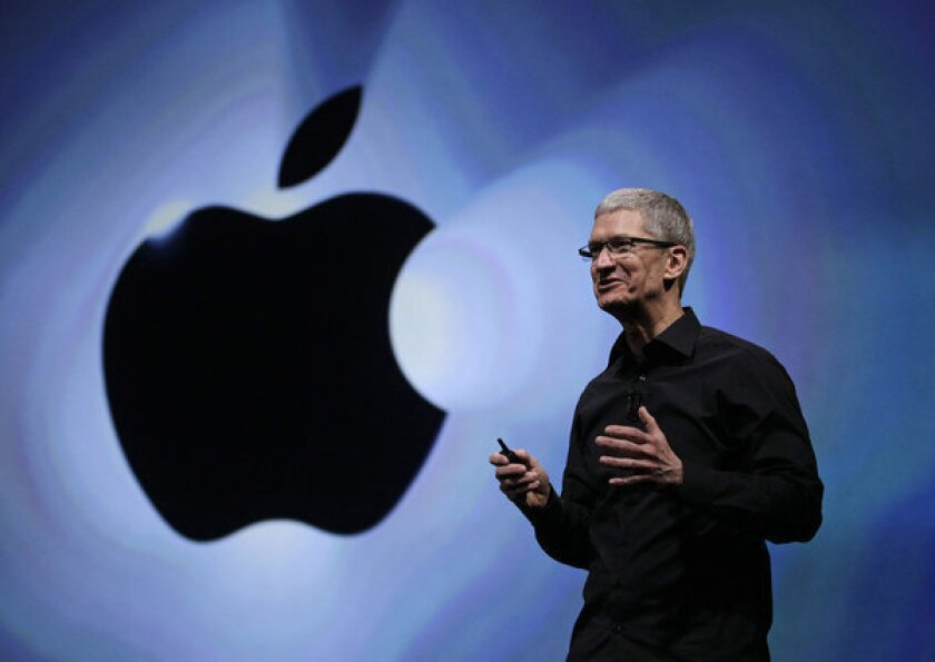 Apple CEO Tim Cook discussed the historic performance of his company during its annual meeting.