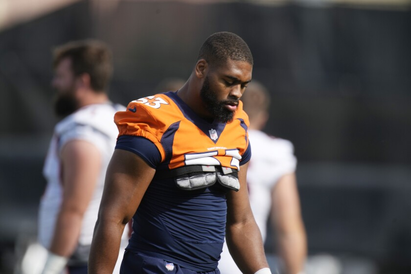 In this Friday, July 30, 2021, file photo, Denver Broncos linebacker Jonathon Cooper heads over to take part in drills at an NFL football training camp in Englewood, Colo. The former Ohio State star expected to get drafted earlier than the 239th pick in Round 7, but an EKG in late April revealed he needed another cardiac ablation, a procedure that scars heart tissue to block electrical signals and restore a normal heart rhythm. (AP Photo/David Zalubowski, File)