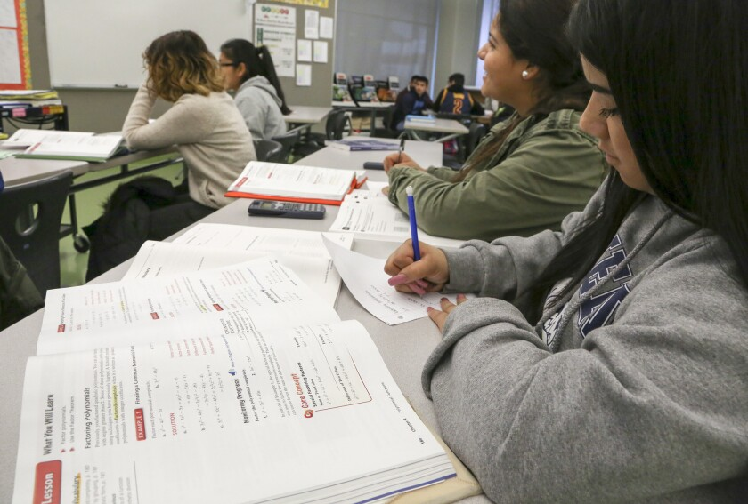 Students take notes in an algebra credit recovery course at Garfield High School in December 2016.