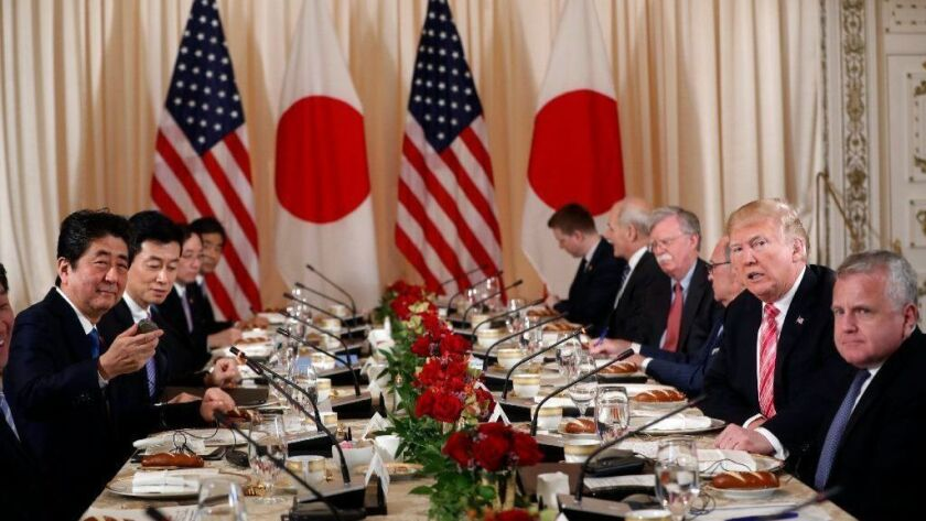 President Trump and U.S. officials hold a working lunch with Japanese officials including Prime Minister Shinzo Abe, left, at Mar-a-Lago in Palm Beach, Fla.