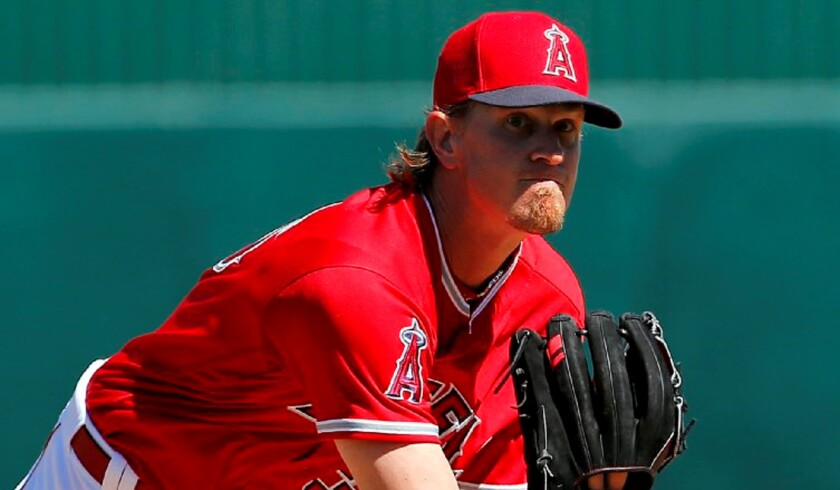 Angels starting pitcher Jered Weaver warms up between innings during a spring training game against the Dodgers.