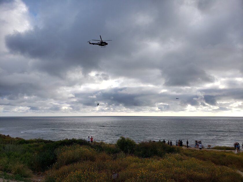 A San Diego Fire-Rescue Department helicopter hoists a woman after she fell Tuesday evening at Sunset Cliffs.