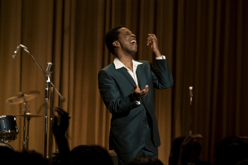 Leslie Odom Jr. as Sam Cooke sings into a microphone