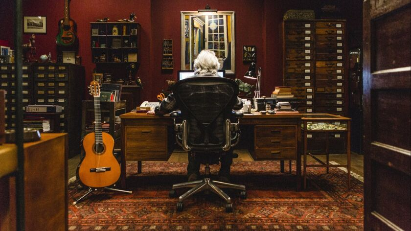 """Bill Wyman working in his archive in a scene from """"The Quiet One."""" Credit: Luke Varley/The Quiet One"""