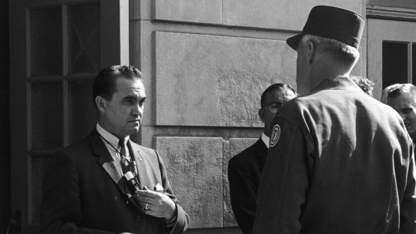 Brigadier Gen. Henry Graham, right, of the Alabama National Guard asks Gov. George Wallace to step aside on order of the president to allow racial integration at the University of Alabama in Tuscaloosa in 1963..